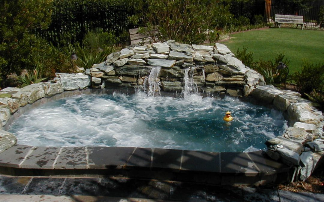 aquatic tub experts outdoor deck hot living with improvement home and company patio hardscape by image pool waterfall natural traditional construction boulders curved