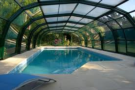 What is a swimming pool enclosure?